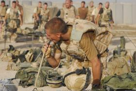 2 PARA soldier takes the chance to rehydrate from a Camel Back water system, FOB Robinson, Afghanistan, 2008