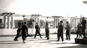 Members of 2 PARA play football on a rooftop while on internal secruity duties, Canal Zone, c1953.