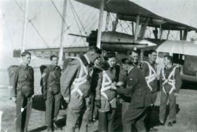 Final checks by jumping instructors prior to training jumps from a Valencia, RAF Chaklala, India, 1942