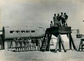 Indian airborne troops are talked through ground training apparatus.