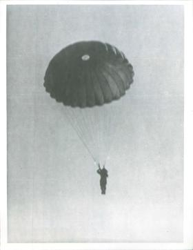Indian paratrooper adopts the landing position prior to landing, New Dehli, India, 1941