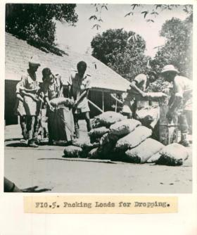 Men from No.1 Indian Air Company pack loads for dropping.