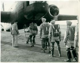 Men emplaning onto a Wellington for their first jumps, India, November 1942.