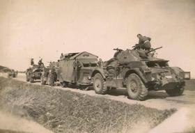 A Staghound Armoured Car with members of 3rd, The King's Own Hussars in Palestine, date unknown.