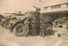 A Staghound Armoured Car in Haifa, Palestine, with members of 3rd, The King's Own Hussars, date unknown.