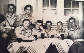 Members of 716 (Airborne) Light Composite Company RASC, enjoying a beer in Palestine, c1946.