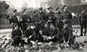 Members of The Parachute Regiment having received medals from King George VI, 1947.
