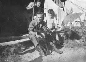 Pte Francis Wood with 'Blondie' the dog, Sarafand camp, April 1946