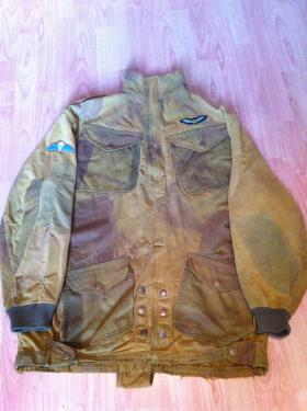Denison Smock 2nd Pattern with cuffs added; no date. 2nd Glider Pilot wings on left breast, late war wings on right arm.