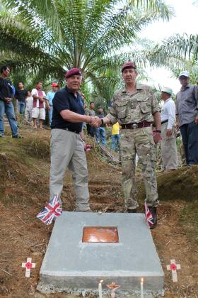 Gil Boyd BEM and Major General Bashall CBE with the plaque on the site of Plaman Mapu, 27 April 2015.