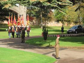 PRA Standard Bearers lead the cortege of Maj Timothy as members of 2 PARA form a Guard of Honour.