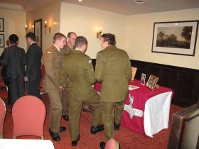 Soldiers from 2 PARA admire Maj Timothy's medals at his Wake, 3 Nov 2011