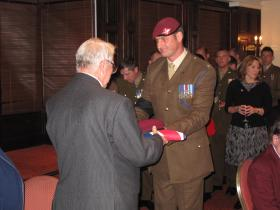 The OC of C (Bruneval) Coy presents Maj Timothy's nephew with a Union Flag and Parachute Regiment Beret, 3 Nov 2011