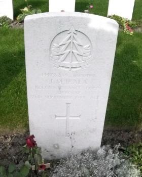 Headstone of Tpr JM Irala, CWGC Anrhem Oosterbeek War Cemetery, 2011.