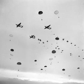 Paratroopers of 16 Airborne Division jump on Ex King's Joker from a vic of American C119s September 1953