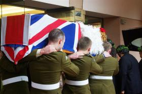 Pallbearers from 3 PARA enter the church for the funeral of Pte John Howard, 21 December 2010