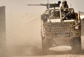 Soldiers from 9 Parachute Squadron, 23 Engineer Regiment, patrolling in a Jackal vehicle, Afghanistan, 2010.