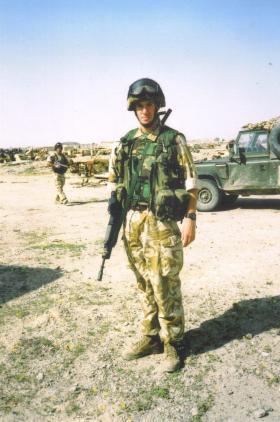 Jason Connolly on a GDA patrol near Shaibah, Iraq, 2004