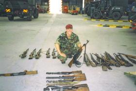 Jason Connolly with a weapons haul from Op Harvest at Mkronic Grad Bus Deport, Bosnia