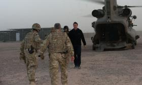 Prime Minister David Cameron is met by members of 16 Air Assault Brigade on a visit to Afghanistan, 2010