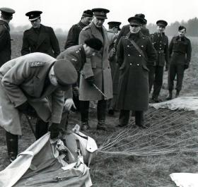 General Sir John Dill inspects a parachute with 11 SAS at Tatton Park December 1940