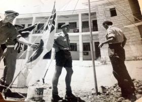 Putting up the Combined Services Flag outside 16th Parachute Brigade Headquarters, Jordan, 1958.