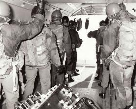 JSFTT members prepare for tail gate freefall exit from an Argosy, 1966