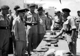 Peter Malone (right) talking to HM King Hussein of Jordan, c1958.