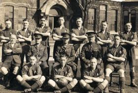Pte Quinn front row, Kings Regt Football team, date unknown.