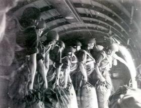 Paratroopers with kitbags preparing to jump from a Vickers Valetta Aircraft, 1950.