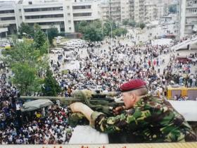 Sgt Paul Tonks protecting Madeleine Albright (US Secretary of State) Kosovo, 1999.