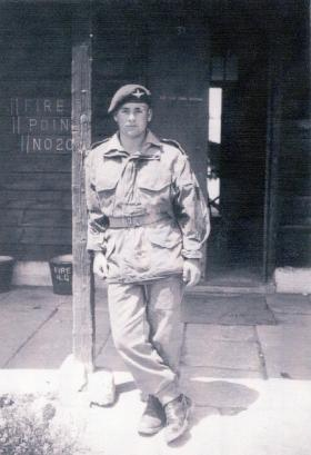 Pte Ken Price outside his accommodation block, Egypt, c1952.