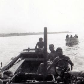 Pte Len Wright at the helm with members of 1 PARA, river patrol, c1956.