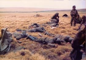 Members of D Coy, 2 PARA, with Argentine prisoners at the Battle for Goose Green, near Boca House, 28 May 1982.