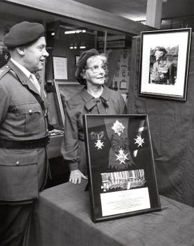 Presentation of Sir Gerald Lathbury's medals to the Parachute museum by Lady Lathbury, c.1983