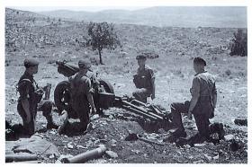 Gun crew of 75mm Howitzer undertake live firing practice, Acre, Palestine, Spring 1947.