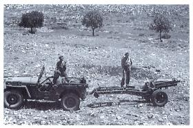 Jeep and 75mm howitzer limbering up at end of shoot live firing practice shoot, Palestine, 1947