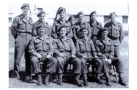 Group portrait of HQ Troop, 33rd Airborne Lt Reg RA, Ramat David, Palestine, 1947.
