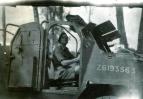 L/Cpl Syd Mundy in a GMC Armoured Car, Singapore, October 1945.
