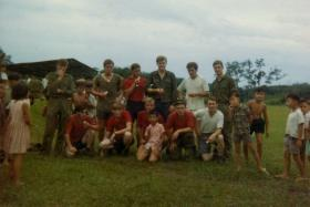 Members of Para Sqn RAC with locals, Malaysia, 1960s.