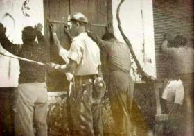 Pte L Wright guarding some EOKA suspects, Cyprus 1955.