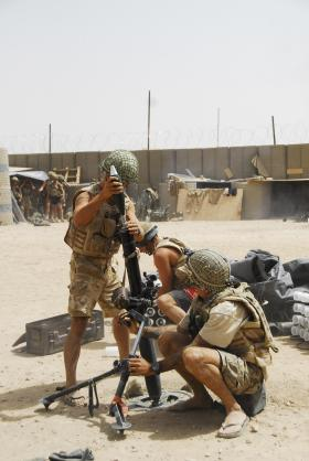 3 PARA mortar team loading 81mm mortar, Musa Qala, Afghanistan, August 2008.