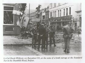 Lt Col Wilford, 1 PARA CO, assesses bomb damage on the Shankhill Road, Belfast, 1972