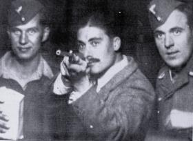 Lt Dennis Rendell at a fair in Sulmona, Italy, flanked by two German soldiers, November 1943.
