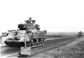 Armour on the move at Lydda Airfield, Palestine, November 1945.