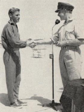 Cpl Macefield receives his prize from Maj Gen Darlng, 1960.