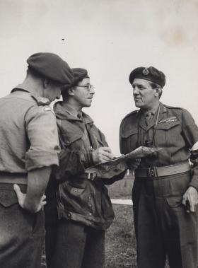 Maj Gen Bourne in discussion with officers of 16th Airborne Division on exercise in Germany BAOR 1952