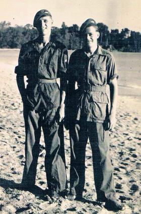 Two members of 7th (LI) Para Bn on a beach in the Far East, c1946.