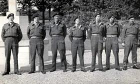 Peter Malone with others at Oosterbeek Cemetery, c1950s.
