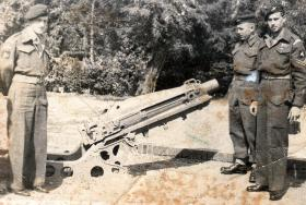 Sgt Malone, second right, with a 75mm Pack Howitzer.
